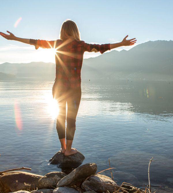 woman lake sunshine mountain