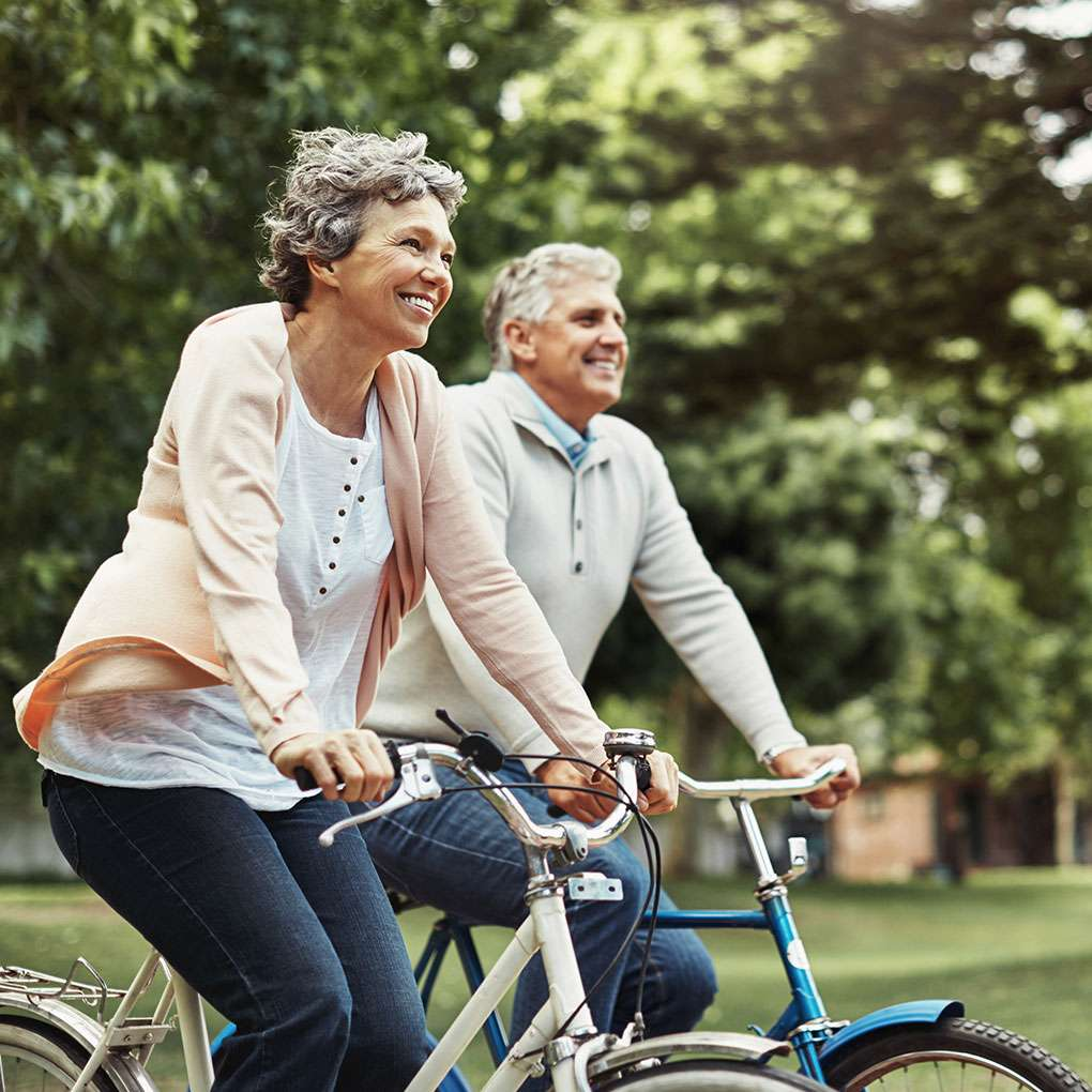 happy mature couple cycling